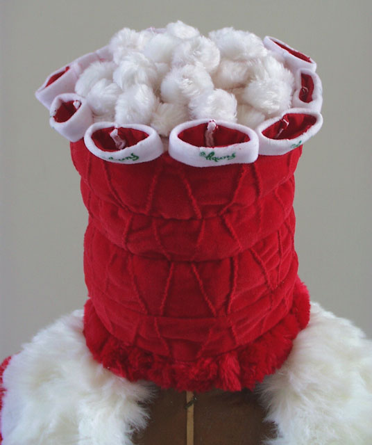 These are Twenty, Twenty Times    (2002) Santa hats from the 400 Limited Edition Christmas Furbies used in the making of   Reflection Loop    (2001)