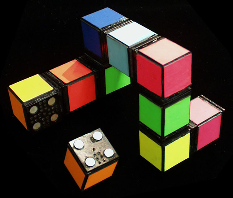 prototype for   Peano  , a system of digital, light-emitting building blocks  (1998) cardboard, plexiglass, magnets and gold-plated contacts