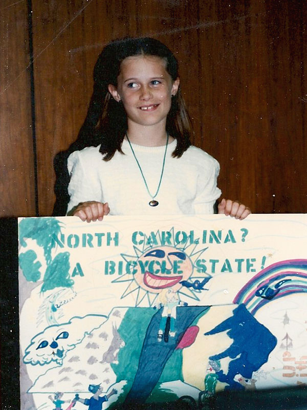 Me at eight years old, receiving my first prize for a state-wide poster contest: a bright red dirt bike.