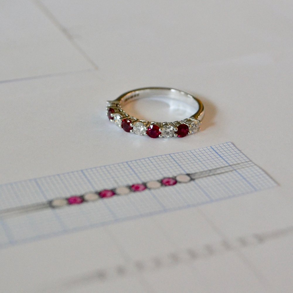 Spanner & Wingnut Bespoke Ruby & Diamond half eternity ring.