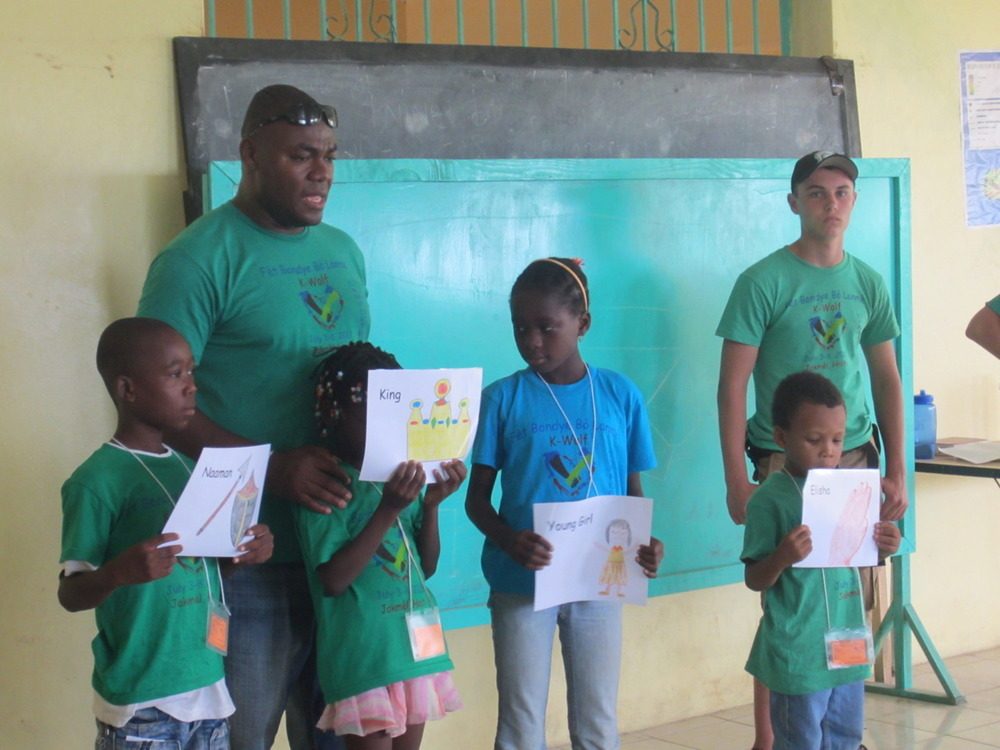 Campers helping tell a Bible story at Fet Bondye Bo Lanme (God's Party By the Sea) 2011 in Jacmel.  This year's camp theme is Care for Creation.
