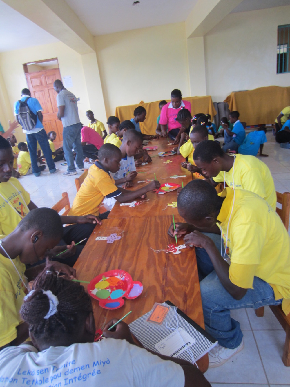 We're about a month out from Fet Bondye Bo Lanme 2012 (God's Party by the Sea): The Best Camp Ever!  Here's a picture from last year's camp of kids painting in Art.