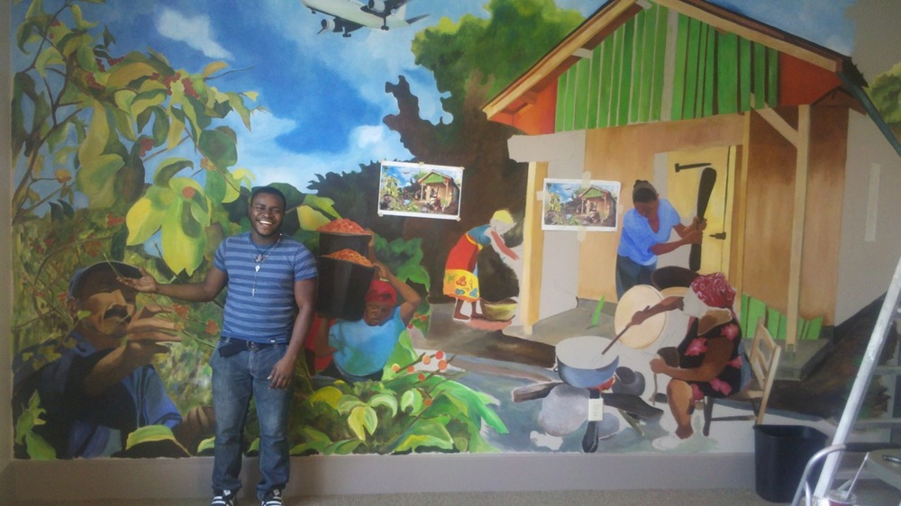 Walnes Cangas from St. Joseph's in front of a mural he's been working on this week at Epiphany Lutheran Church in Suwanee, GA for their Holy Beans Cafe!  Holy Beans will sell Haitian coffee through an HTF partnership.