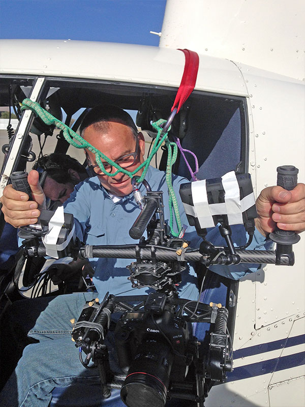 Director of Photography Mark Thomas strapped into a helicopter with our Movi M10.