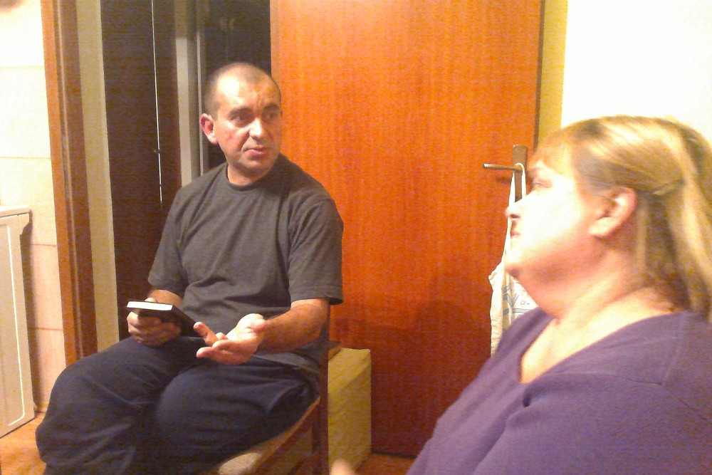 Pastor Mario shares with Kathy Eikost.