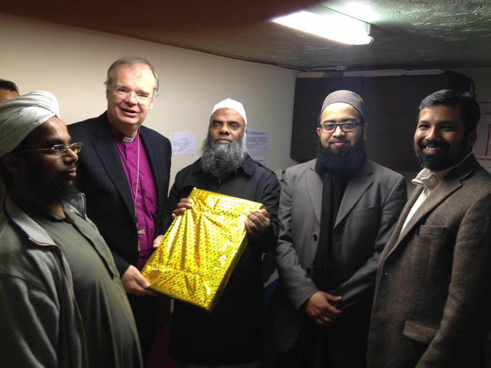 Bishop Richard being felicitated at the Bury Park Jamia Masjid.jpg