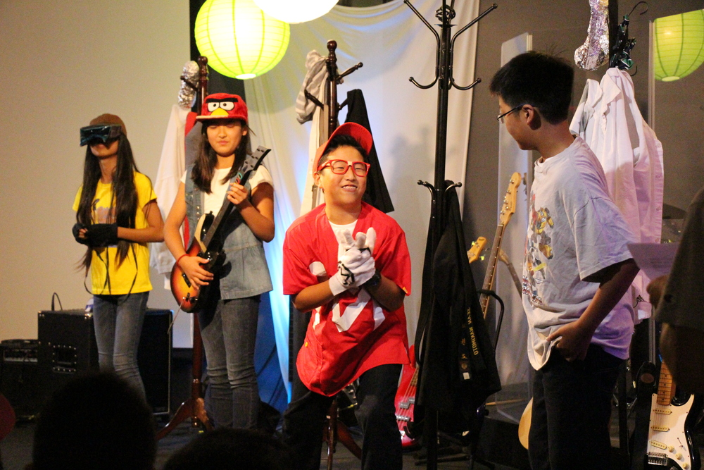 Our students then performed a skit about 4 very accomplished middle schoolers (a  fashionista, a tai-chi champion, a student council activist, and a world-class gamer) who think they've made it to the top. But at the  end of the day, our heroes all feel frustrated and dissatisfied with what they've done to try to fit in, and start to wonder if their friends know something that they don't.