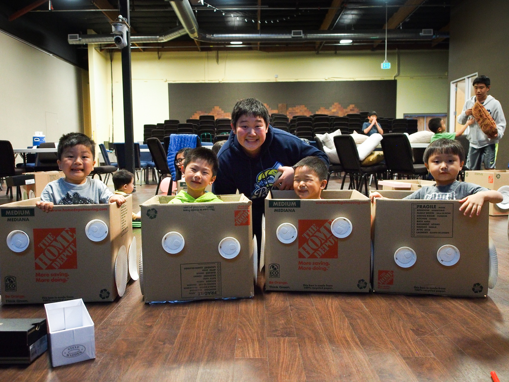 Afterwards, we had a drive-in movie night, where we helped build box cars for the kids. Lookin' pretty awesome.