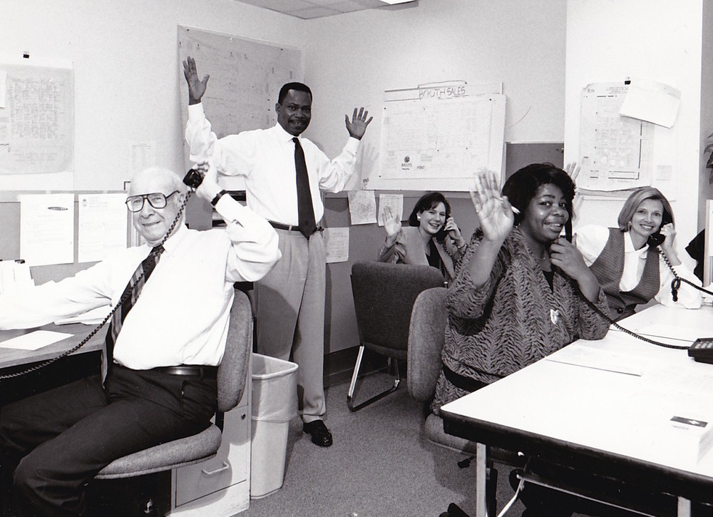 The Corcoran sales team busy selling booths in 1994. Pictured: (L to R) Ward Gill, Cliff Ruffin, Jeanne Corcoran, Debbie Corcoran and Karen Gaines.
