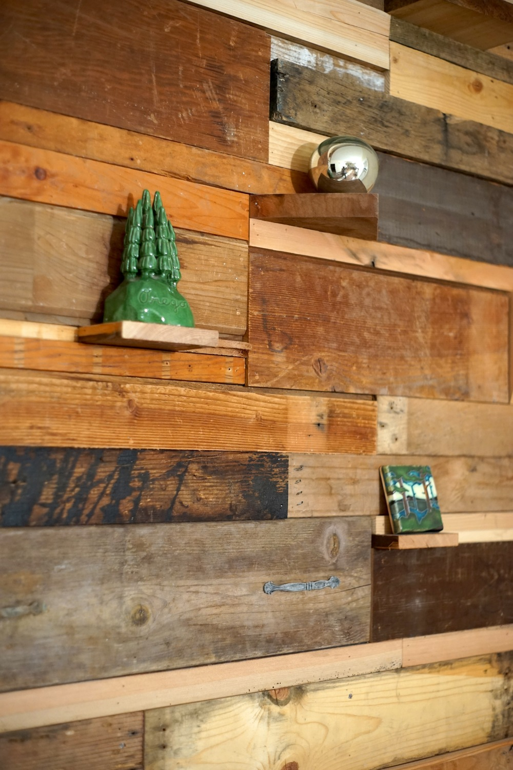 Salvage wood wall in remodeled living room. Created by craftsman Greg Simons of  Studio G .