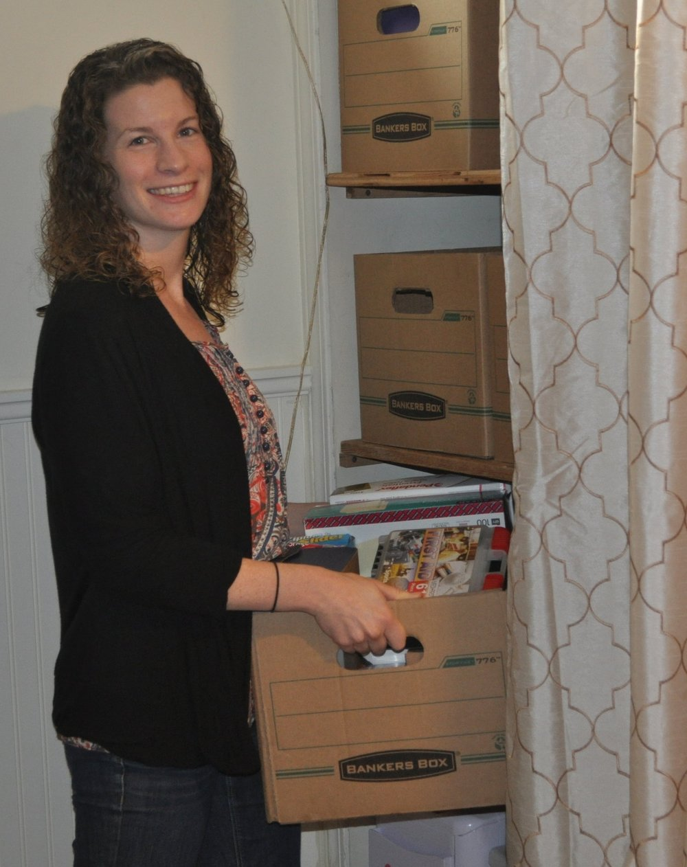 Casey organizing boxes and making space for a client.