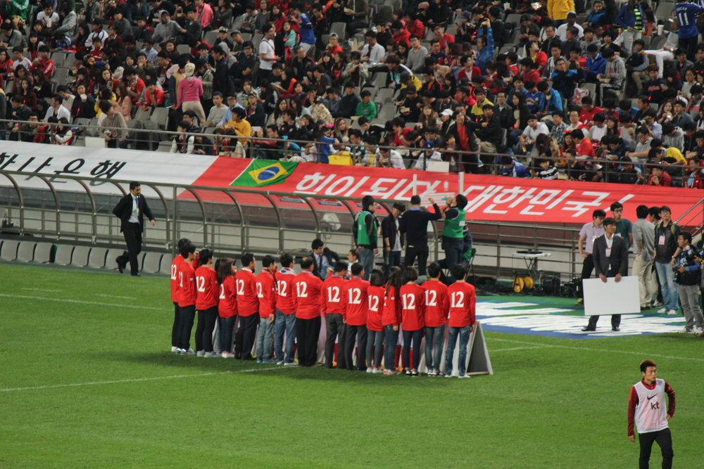 Soccer fans on the field waiting for their favorite Korean player.