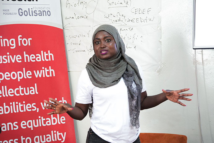 During the workshop, Sophie Diop, Speak Up Africa's Sanitation Program Officer, leads participants in a demonstration of various feminine hygiene products.