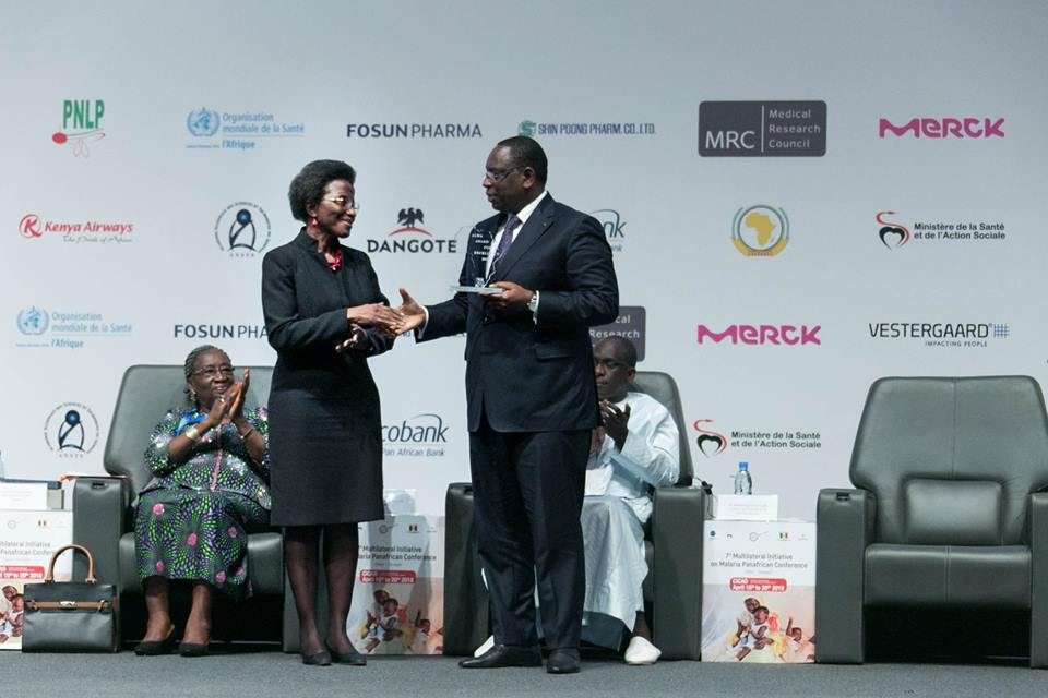 Senegalese President, H.E. Macky Sall accepting the African Leaders Malaria Alliance (ALMA) Award for Excellence from ALMA Executive Secretary Joy Phumaphi during the #MIM2018 opening ceremony.