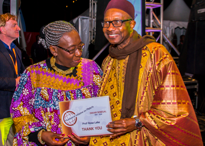 Prof. Gaye presents Prof. Rose Leke, Chair of the MIM Secretariat andEmeritus Professor of Immunology and Parasitology, Faculty of Medicine and Biomedical Sciences, University of Yaounde, Cameroon , with a certificate of appreciation.