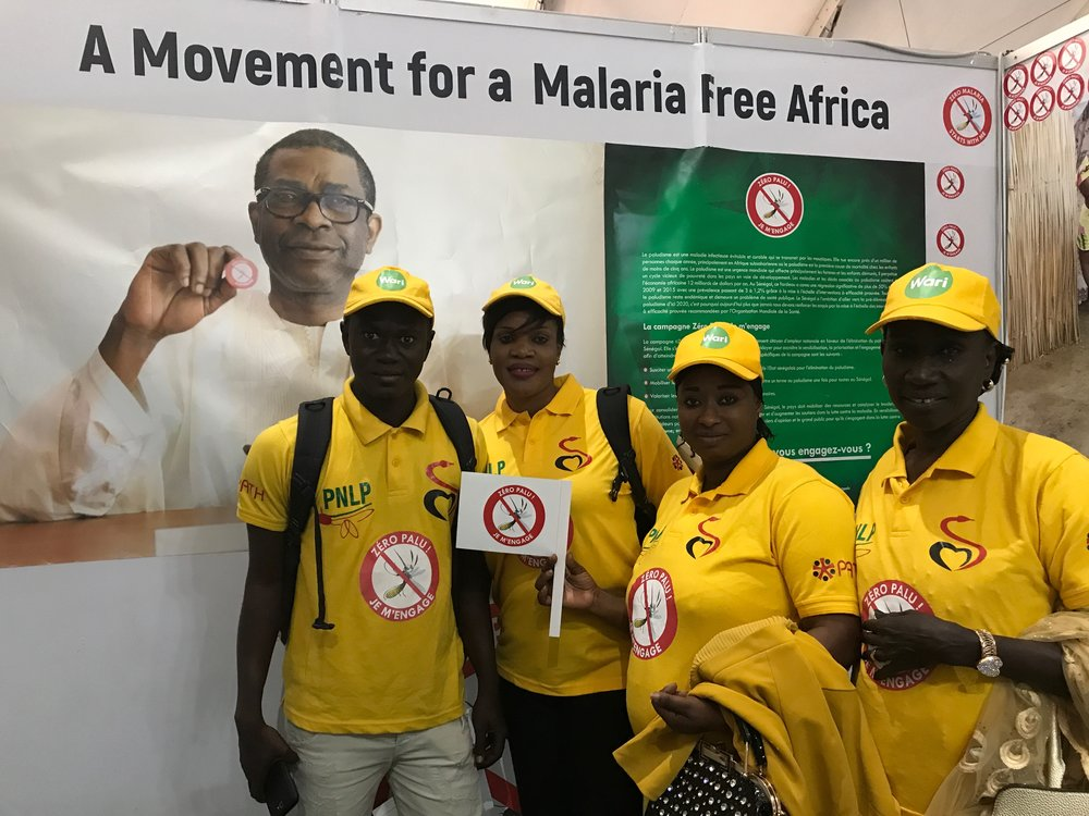 """Zero Malaria Starts with Me"" champions visiting the campaign booth in the MIM exhibition tent."
