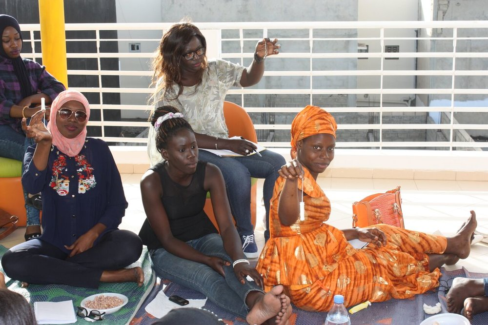 Young women from Soeur de Coeur participate in a menstrual hygiene management workshop at the Speak Up Africa Lab. The workshop teaches participants about the diversity of menstrual products available to help them manage their periods well.