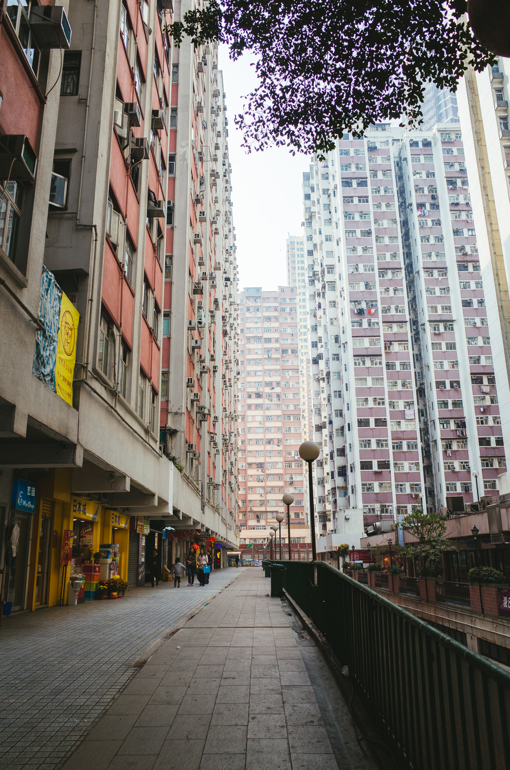 I'm currently residing in HKU's Residential Colleges in Sai Wan. Just down the steep decline is the humble Kennedy Town. Government housing, small restaurants and construction. I often traverse the same route down in order to travel to various locations in Hong Kong and Kowloon alike, and I can't help but admire the verticality and leading lines every corner I turn.