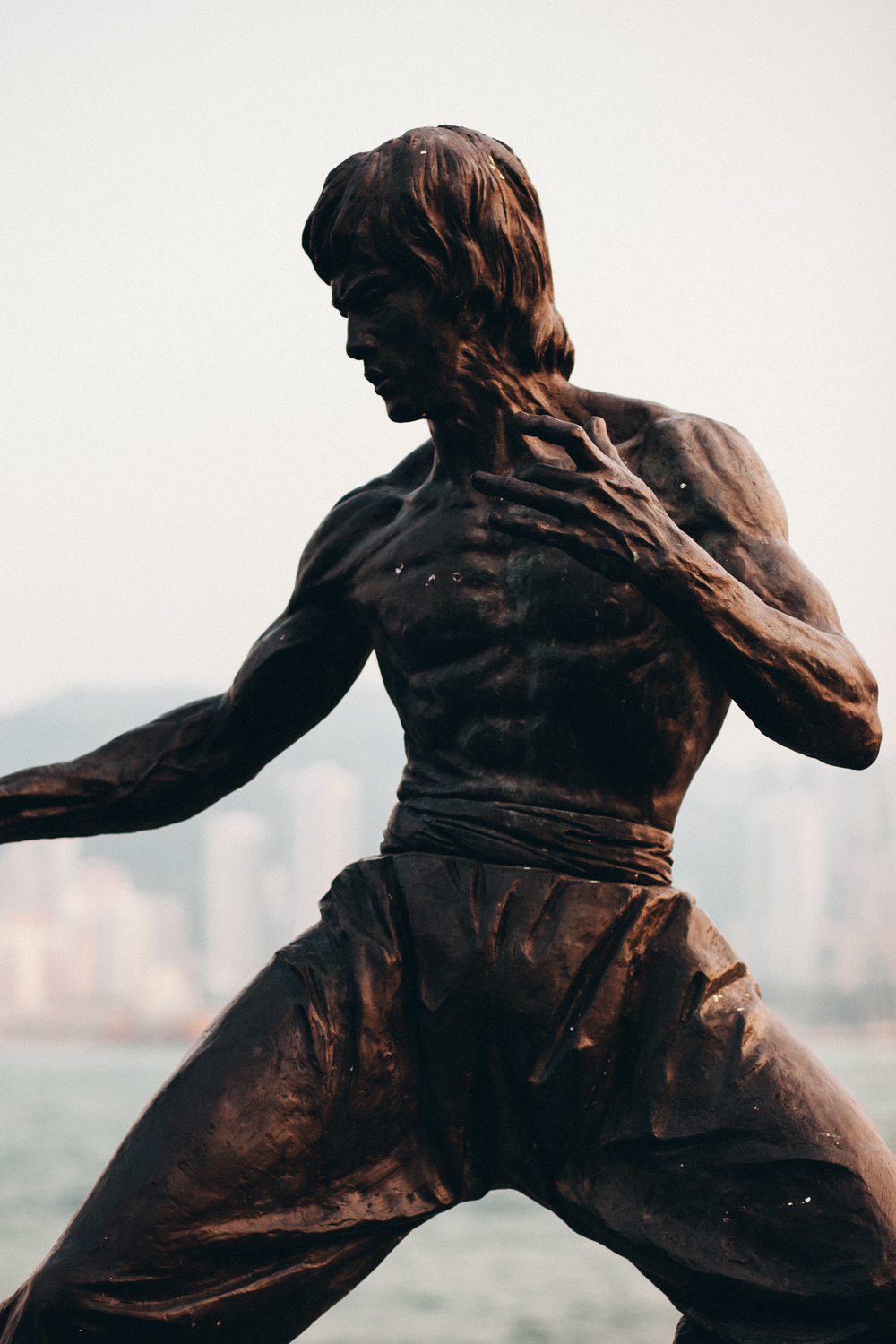This bronze sculpture honours one of the most iconic martial artists and actors to hail from Hong Kong - none other than the one and only Bruce Lee.