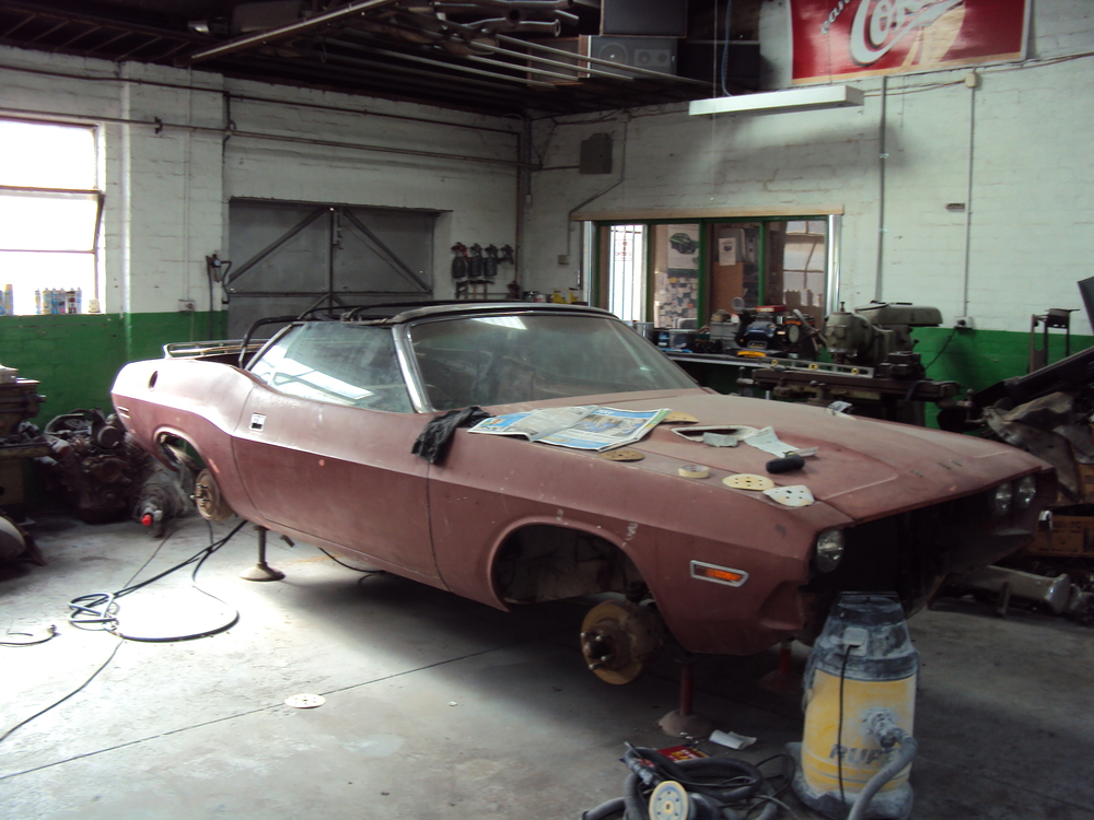 Before.  This 1970 Dodge Challenger was a basket case.  Brians passion is to bring such a beautiful beast back to life.