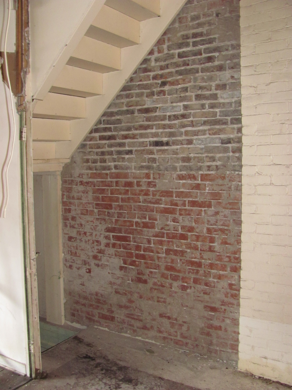 That stairwell will be disappearing soon giving us more space to work with in the front of the store.