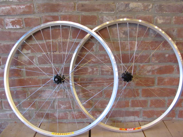 Katharine positioned the rims so that the stickers read Velocity on the front and Dyad on the rear and vice versa from the other side.  Otherwise they would read Velocity Velocity or Dyad Dyad.  Small touches make hand built wheels special.