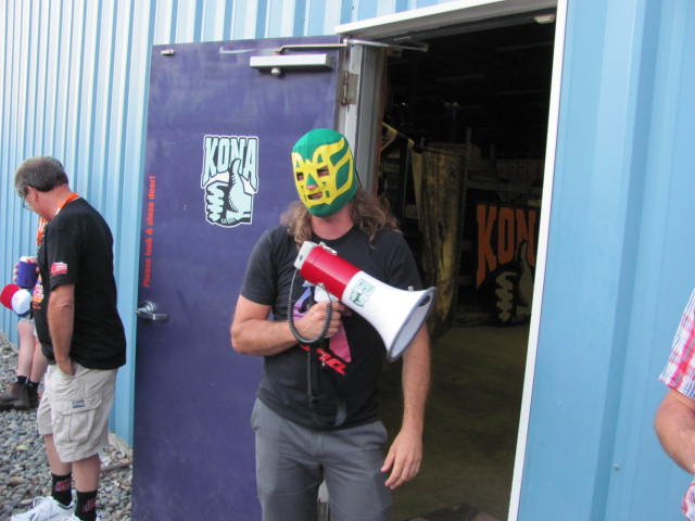 Kona sales rep Joe presiding over the blindfolded bike Piñata with a luchador mask and a megaphone for extra fun.