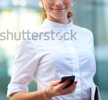 stock-photo-pretty-young-business-woman-with-newspaper-using-mobile-phone-104586956.png