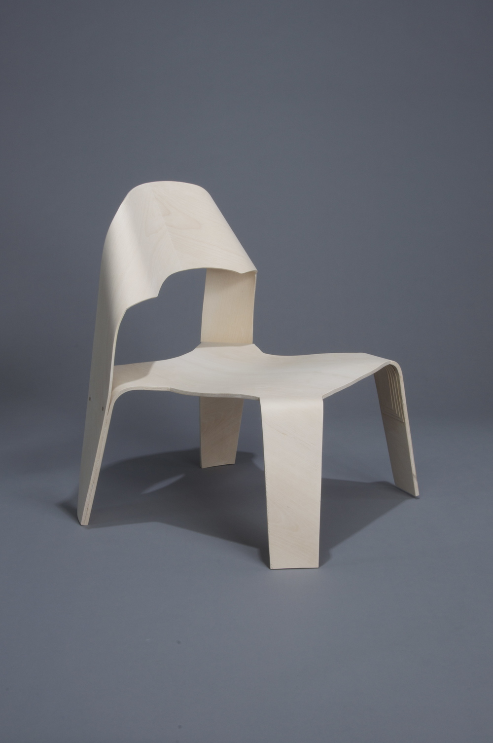 The Copenhagen Lounger was made during a two-month study abroad in Copenhagen, Denmark. The lounger was designed after a weeklong study tour of Finland and Sweden and the study of the history of Danish functionalism. The entire chair is made of beech veneer formed using a vacuum-bagging technique to mold both the chair and backrest components, which were later, joined with a walnut dowel.  2011.