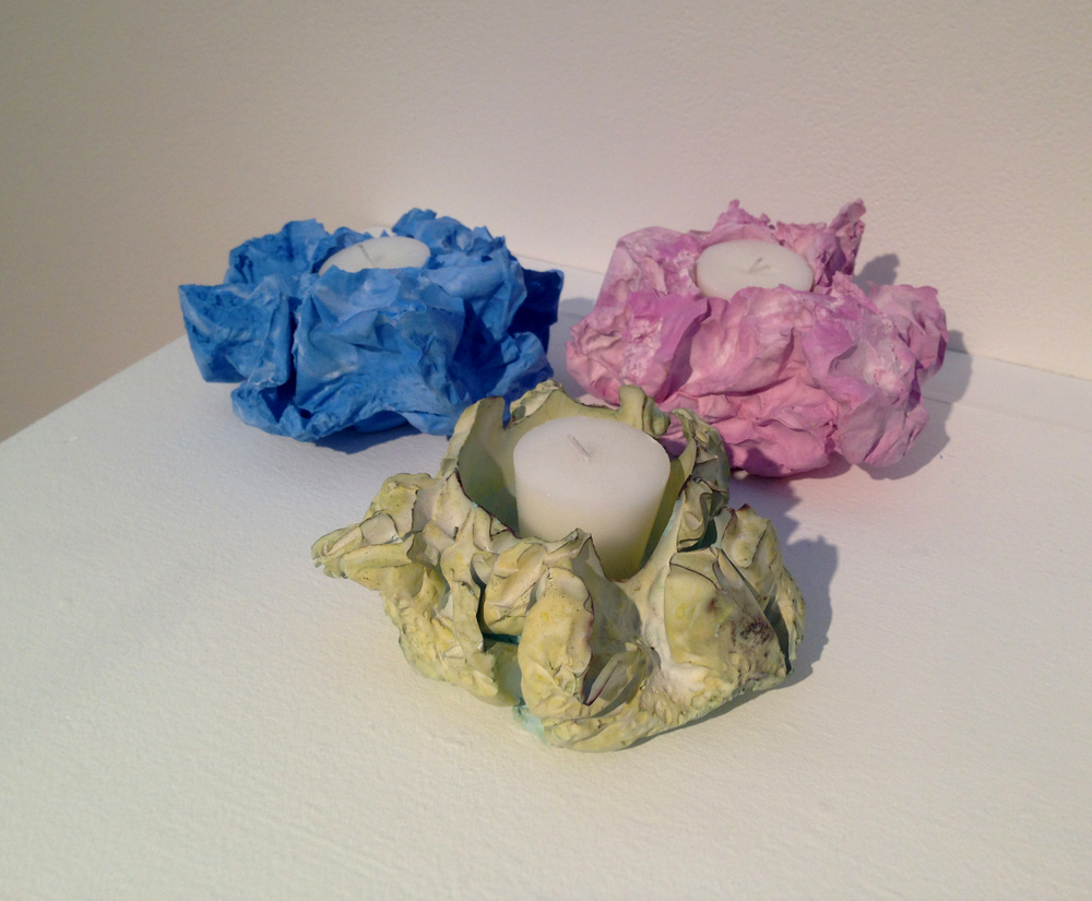 The Tyvek votives are created using a sacrificial heat-formed Tyvek mold. The votives get their distinctive coloration when water-based due leaves the plaster during the drying process.
