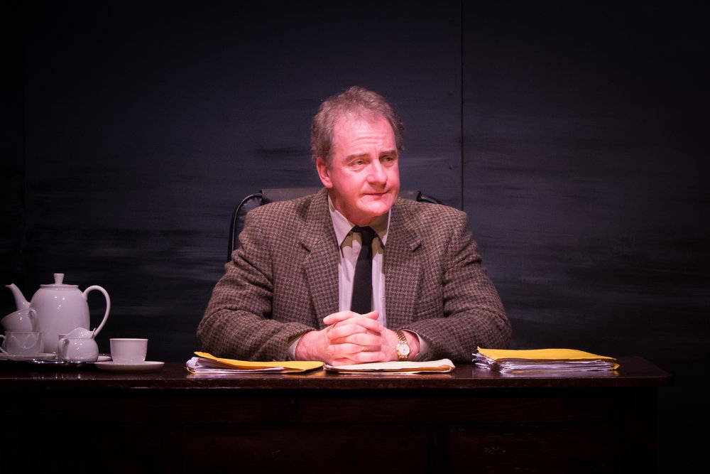 Rob Defries as lawyer John Lauder.jpg