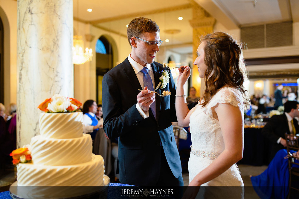 cake-cutting-indianapolis-wedding-photographers-jeremy-haynes-photography-pipers-at-the-marott.jpg