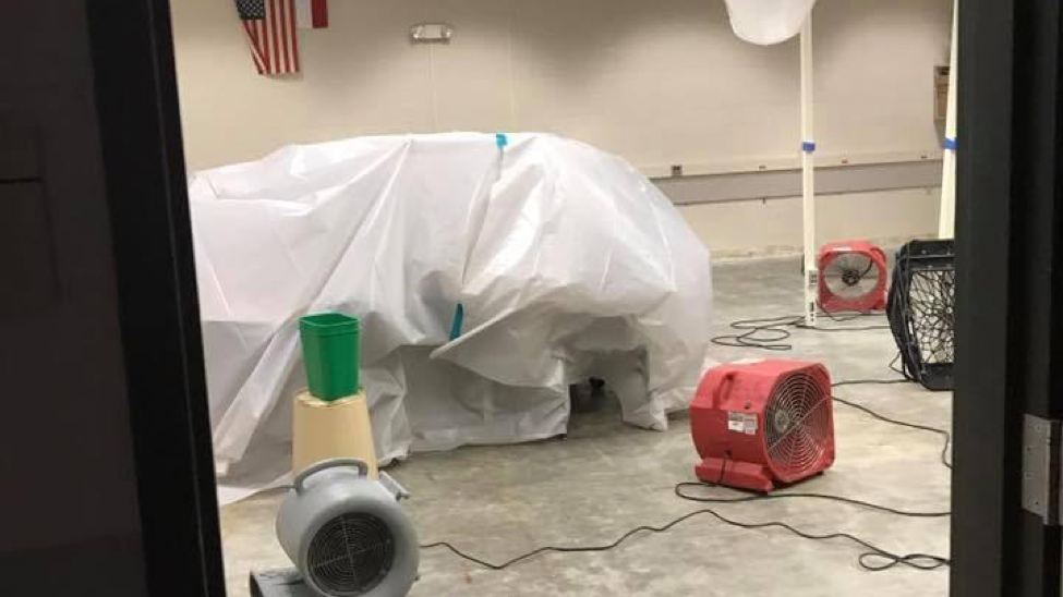 Picture of one of our classrooms with dehumidifiers and stripped of carpet. Carpet was fully replaced across the entire building by February of that year.