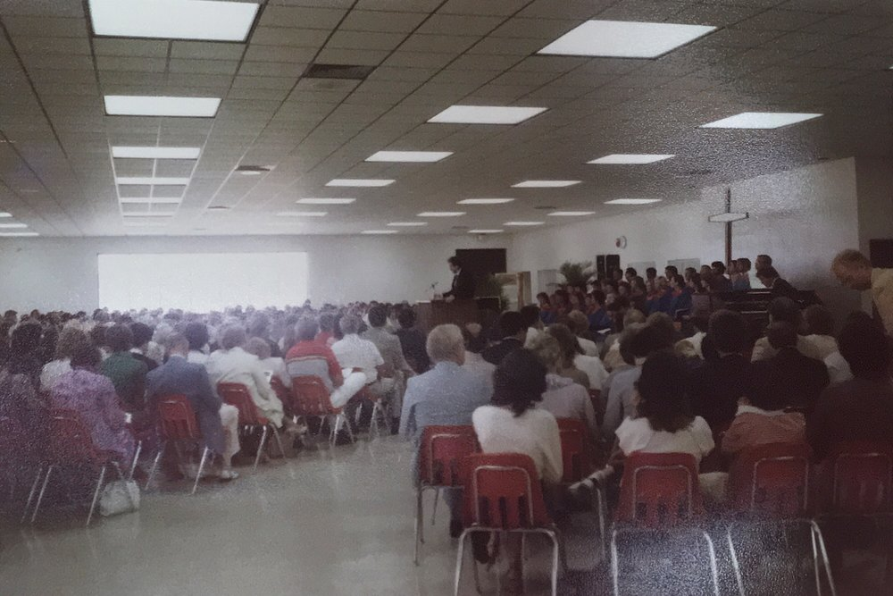 A worship service being held in the Spanish River High School cafeteria.