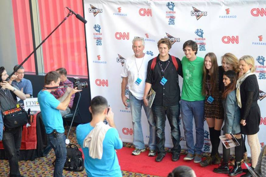 Andrew Jenks taking pictures on the red carpet with Best Music Video winners Lucas Dudley, Emma Bradford and family from Sacramento, CA.