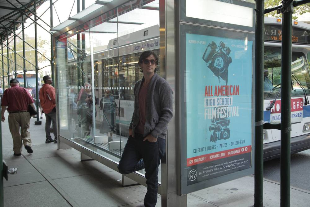 Andrew Jenks in front AAHSFF, Made In New York sponsored, Bus Shelter.