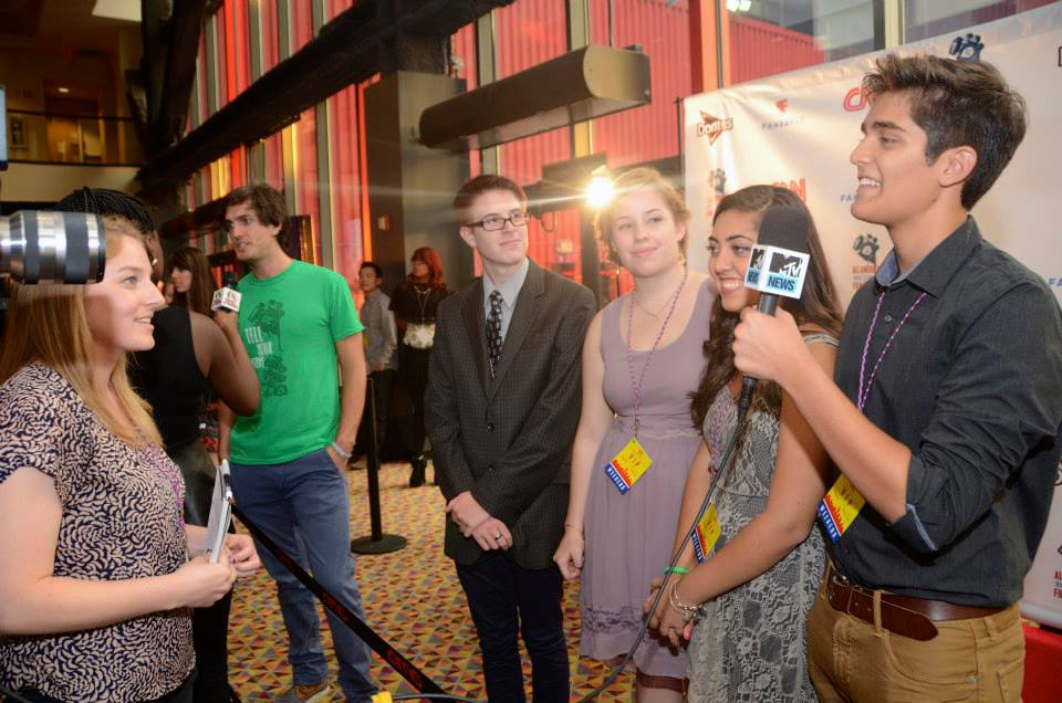 MTV News interviewing filmmakers on the red carpet.