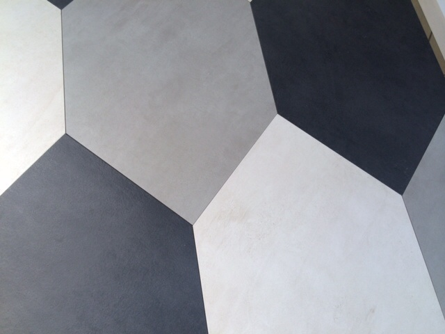 we all know that tile is not just faboo on the floor, but can be equally or more dramatic when placed on the wall and celebrated as a feature wall.  skewed hexagon tile by ames. mixed + matched (as seen) or  keep uniform . has a concrete look to it too !!