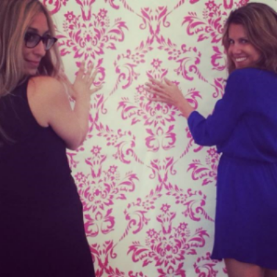 Have to ham it up at a soiree. Design Shop business partner Deb + Amanda strike a pose in front of their custom (very easy to remove and non damaging) tent wall vinyl. Again, this detail was intended to echo the wall covering feature wall indicated in the Glass House lobby rendering.