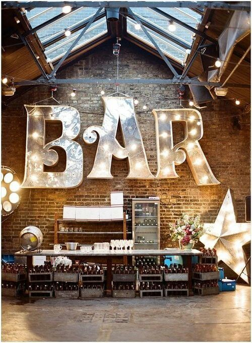 bar star. signage that is so pronounced and bedazzling you barely notice the lack of investment in the actual bar back!  over compensate much? #designbehaviorismatitsbest