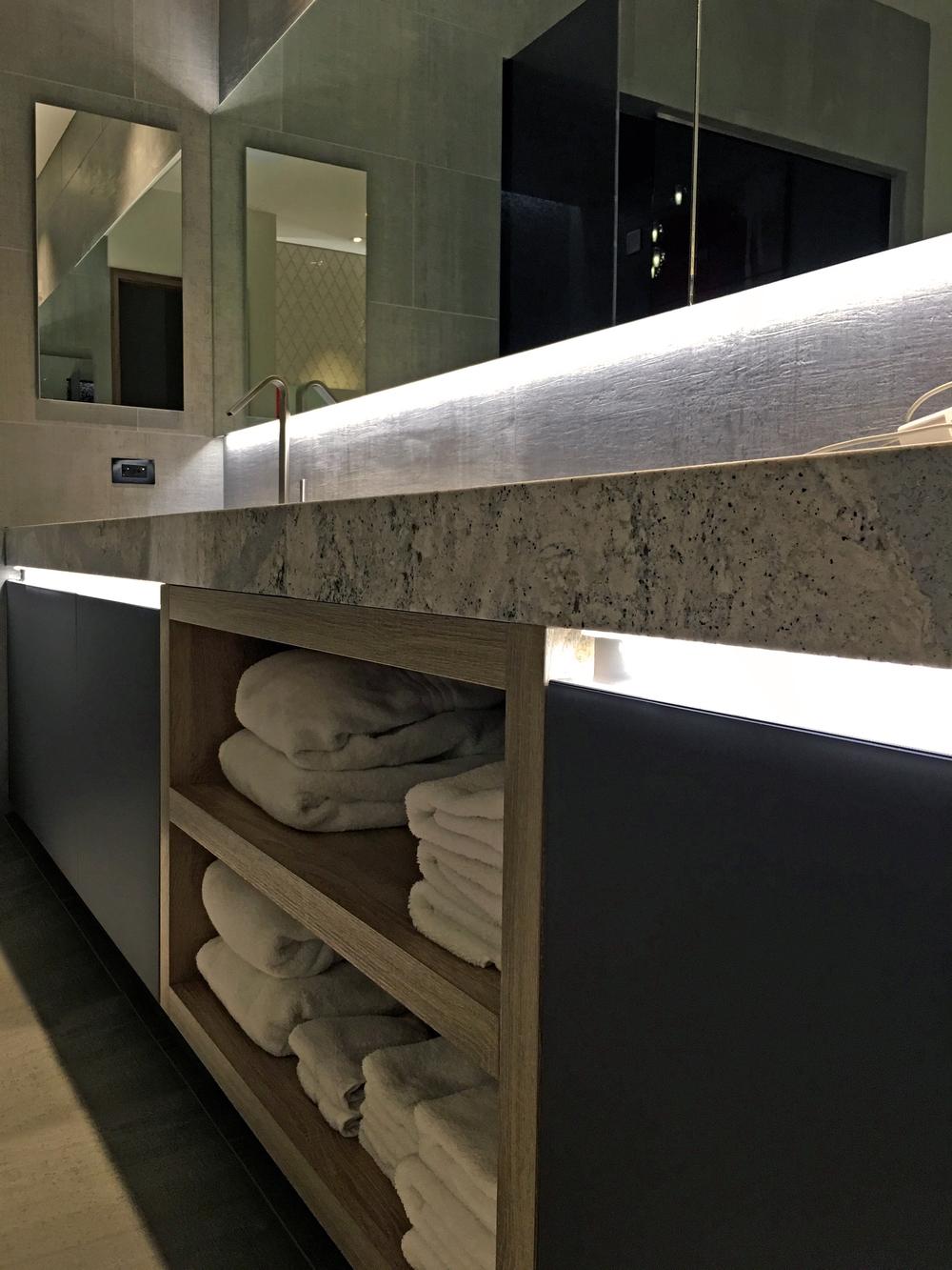 bathroom open shelves quartz concrete.jpg