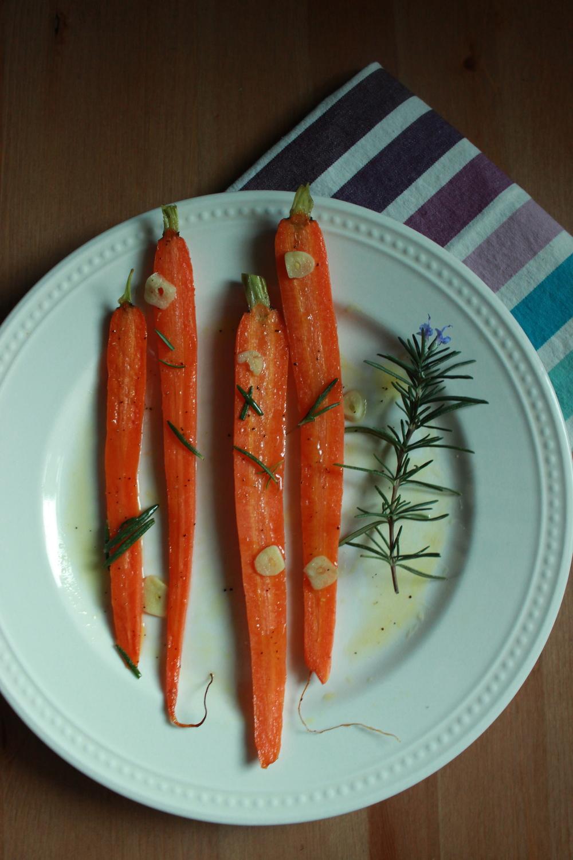 honey glazed carrots roasted with rosemary-infused olive oil + garlic