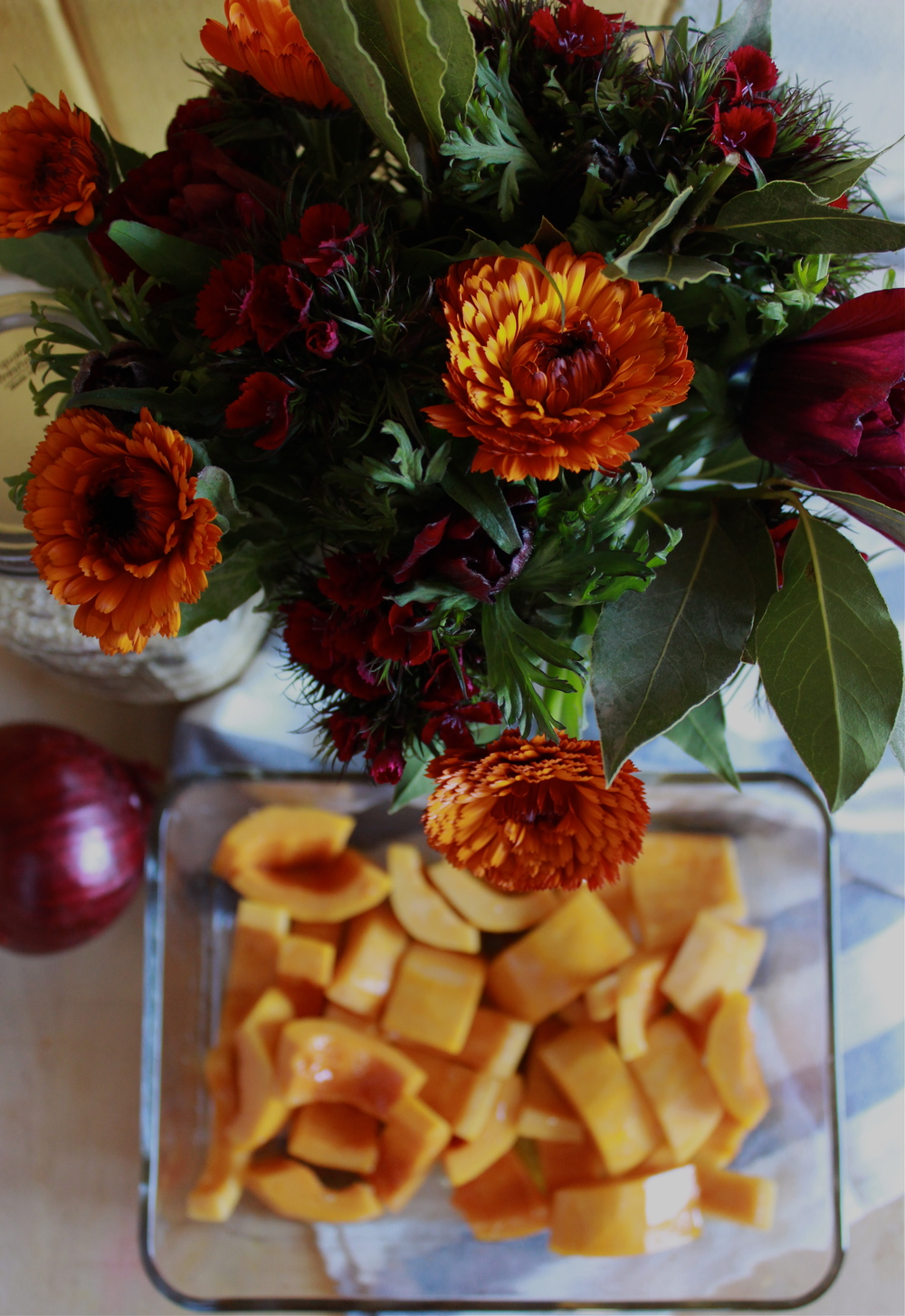 flowers and squash at half galley kitchen