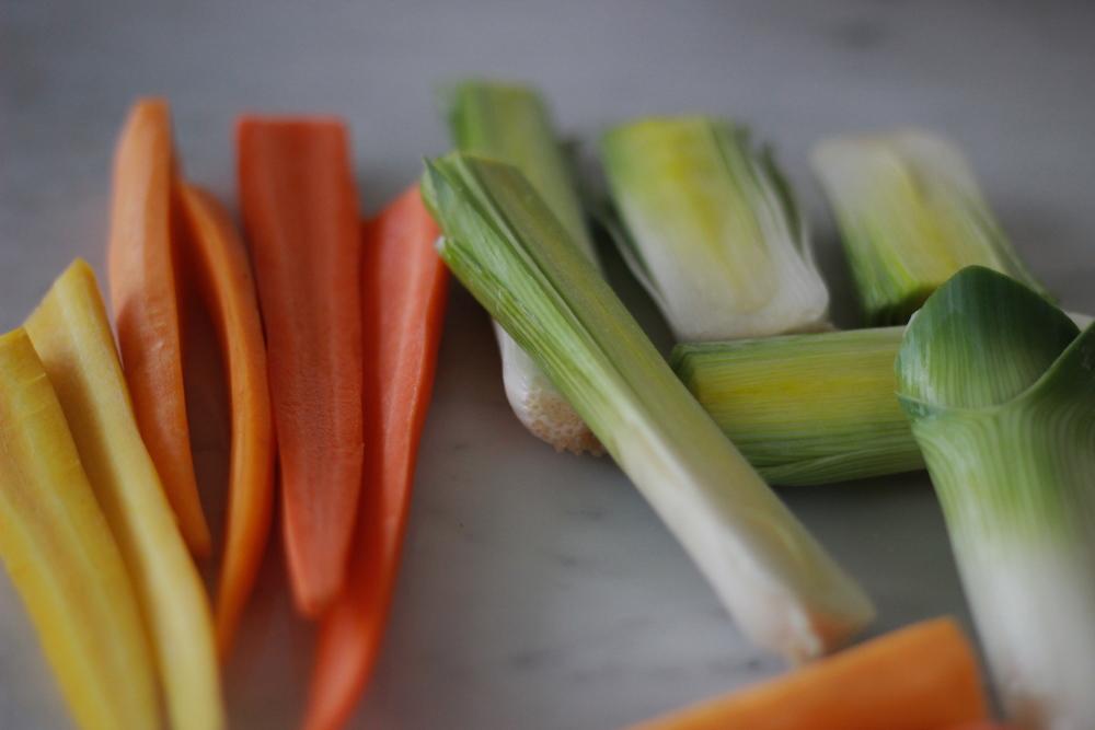 sliced rainbow carrots + leeks | half galley kitchen