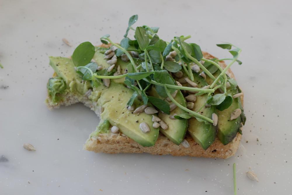 open faced sandwich no. 1: avocado, pea shoot, sunflower seeds | half galley kitchen