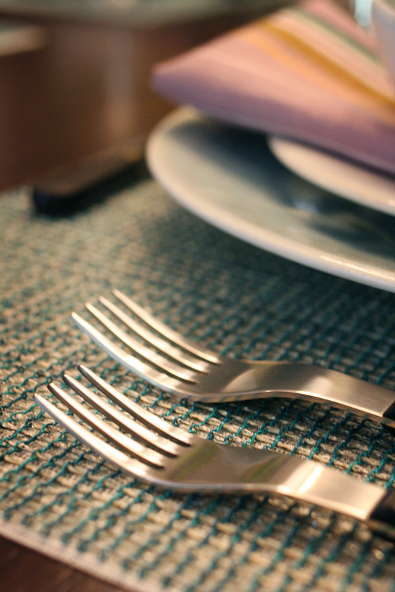 Chilewich Lattice placemat layered atop white mat, Provencal flatware