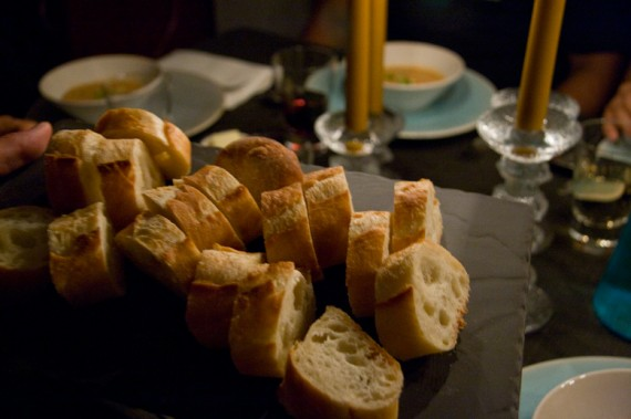 crisp baguette served on a porcelain tray from revol's basalt collection