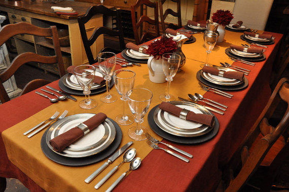 Antique farm table, set with Libeco Home linens, Match Pewter dinnerware, and Simon Pearce glassware