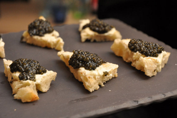 Caviar on toast with crème fraiche, served on a Revol Basalt slate plate