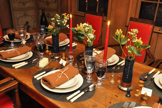 The table, set with Simon Pearce dinnerware and glassware, Chilewich placemats, Sabre cutlery, and Libeco Home linens